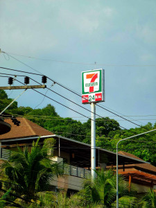 Highly visible and unavoidable: the orange-green sign of 7-Eleven